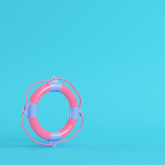Pink life buoy on bright blue background in pastel colors