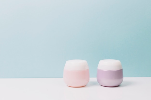 Pink and lilac cosmetics jars