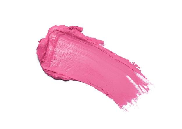 Pink lipstick brush stroke isolated on white