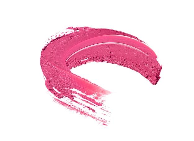 Pink lipstick brush stroke isolated on white Premium Photo