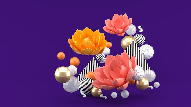 The pink lotus among the colorful balls on the purple space Premium Photo