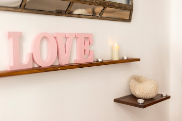 Pink love lettering on shelf