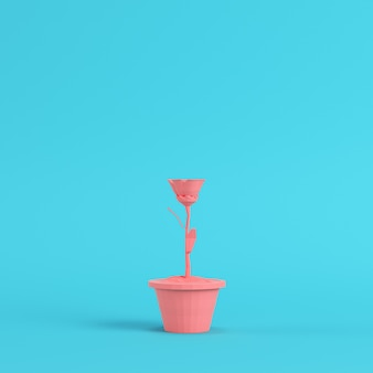 Pink low poly flower in a pot on bright blue background