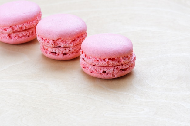 Pink macaron on wooden background