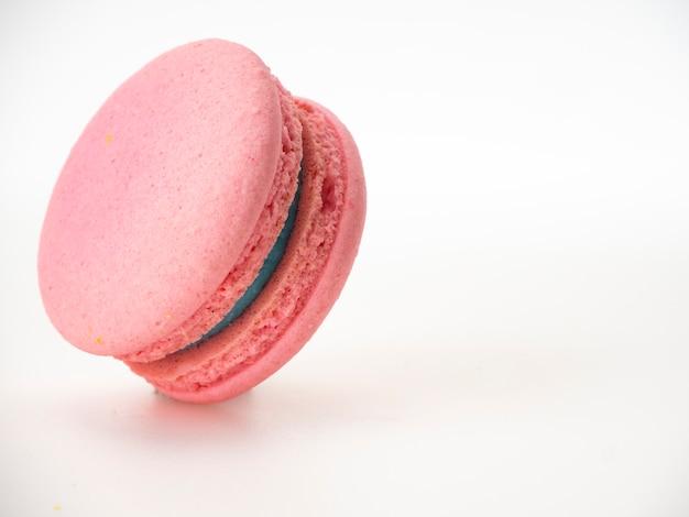 Pink macaroon on white background