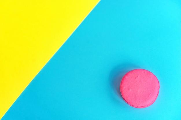 Pink macaroons on a yellow background