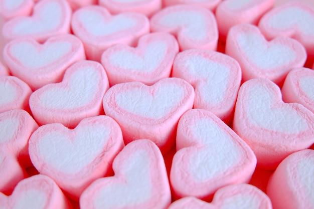 Pink marshmallow background, heart marshmallow texture background, valentine background