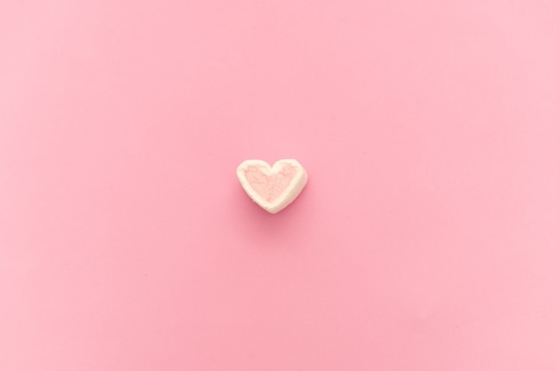 Pink marshmallow in a gift box in form of heart on textile background, many hearts marshmallows for present, sweets in the form of hearts of marshmallow. valentine's day gift