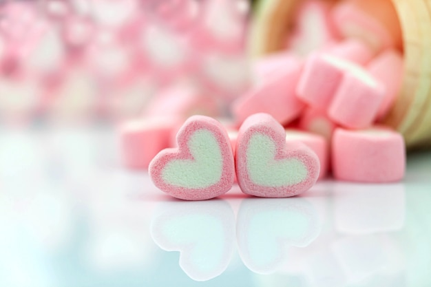 Pink marshmallow in heart shape  on  table with copy space