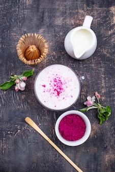 Pink matcha latte with milk