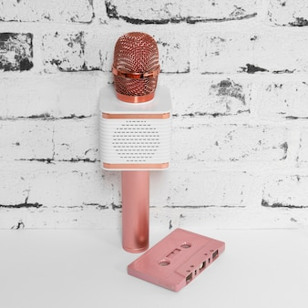 Pink microphone and old cassette