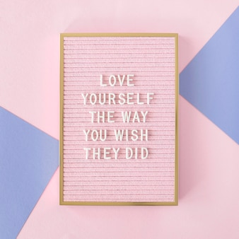 Pink motivational text board flat lay