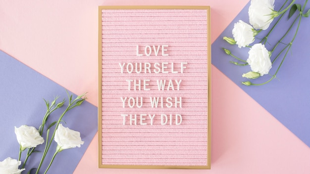 Pink motivational text board above view