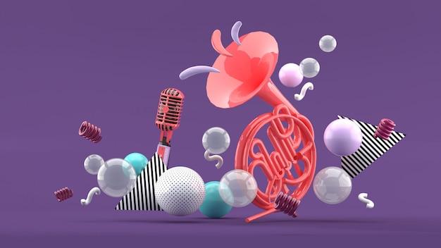 Розовые музыкальные инструменты на фоне разноцветных шариков на синий и фиолетовый. 3d визуализация.