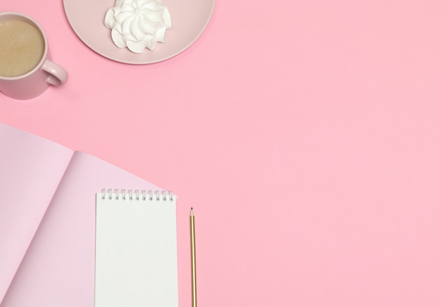 Pink note paper, coffee cup, cake on pink background
