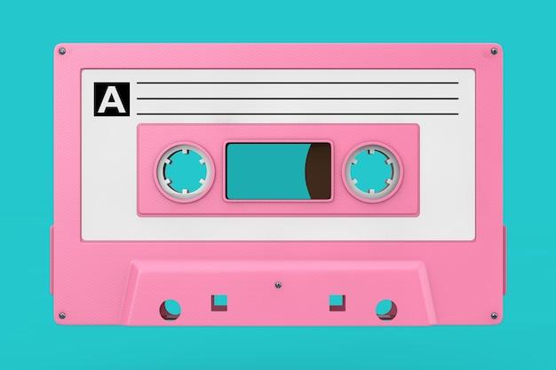 ピンクの古いビンテージオーディオカセットテープは青い背景にモックアップします。 3dレンダリング