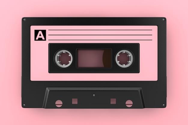 ピンクの背景にピンクの古いヴィンテージオーディオカセットテープ。 3dレンダリング