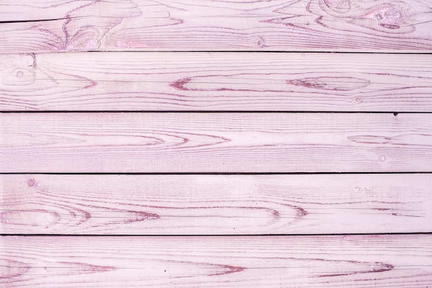 Pink old wood texture backgrounds. horizontal stripes, boards. roughness and cracks.