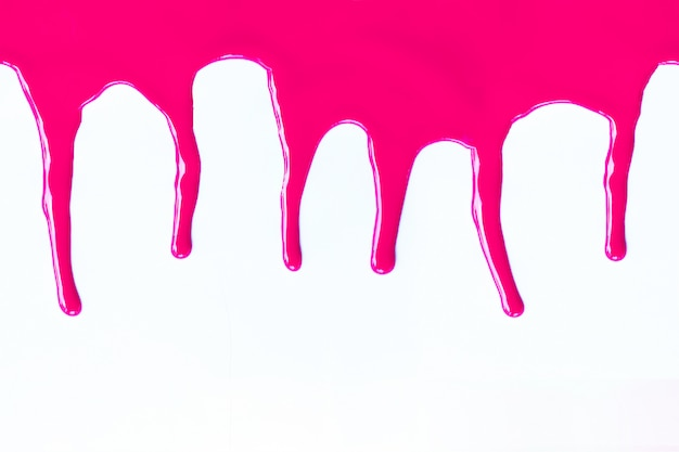 Pink paint dripping on a white.