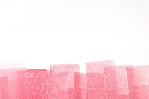 キャンバスにピンクのペンキ
