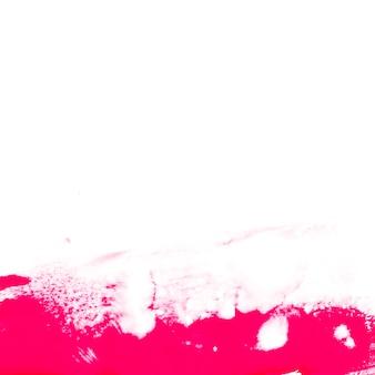 白い背景にピンクのペイント
