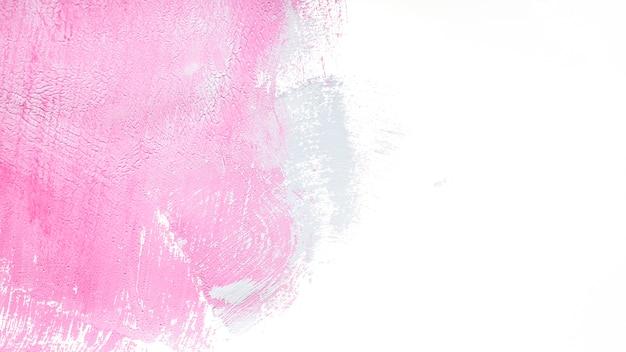 テクスチャの白いピンクのペイント
