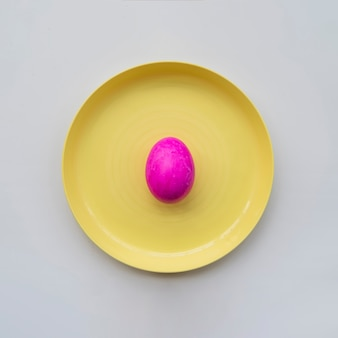 Pink painted egg on plate