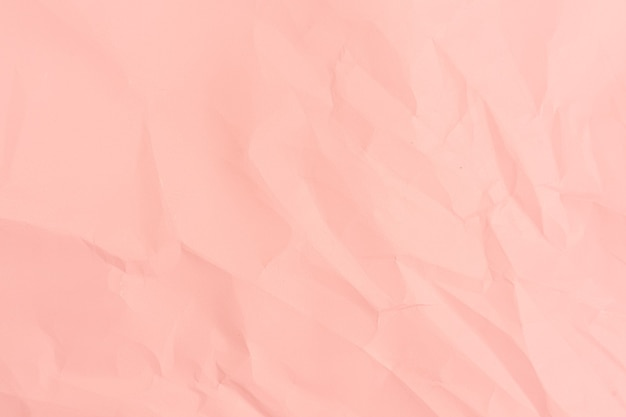 Pink paper background. crumpled pink paper texture.