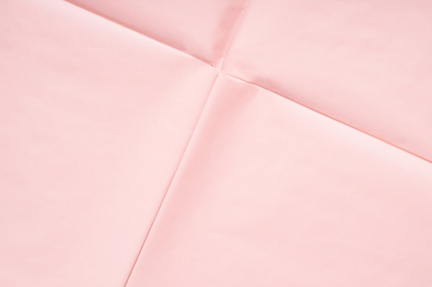 Pink paper background with crease texture