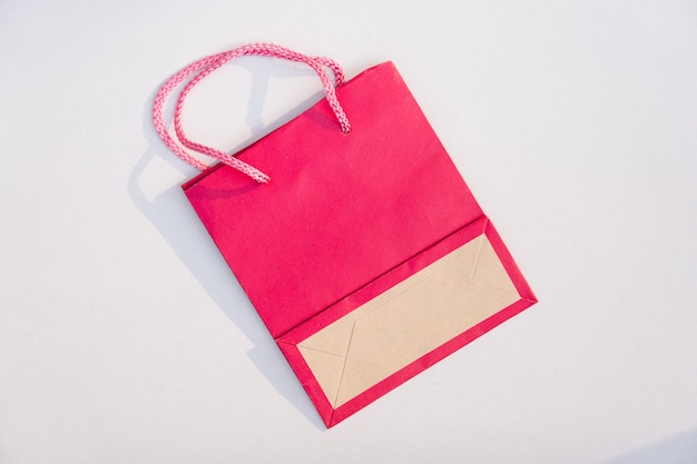 Pink paper bag on white background
