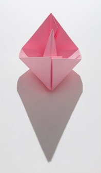 Pink paper boat with copy-space