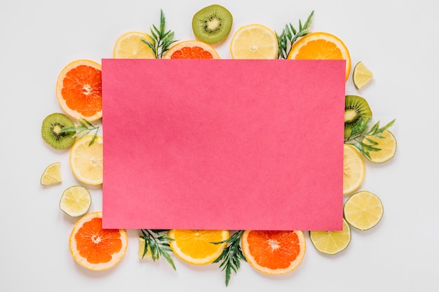 Pink paper of delicious sliced fruits