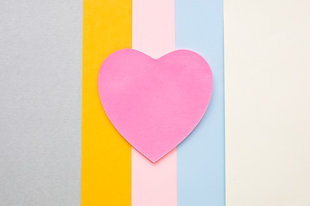 Pink paper heart on bright table