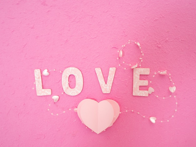 Pink paper hearts message of love