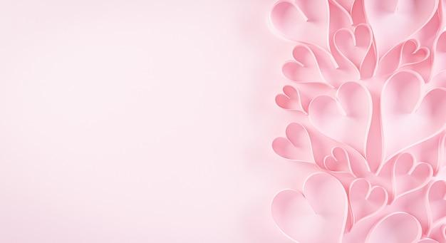 Розовые бумажные сердечки на пастельной бумаге