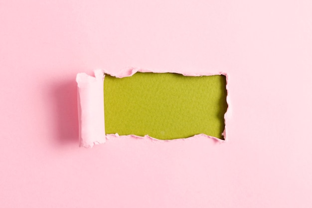 Pink paper sheet with green mock-up