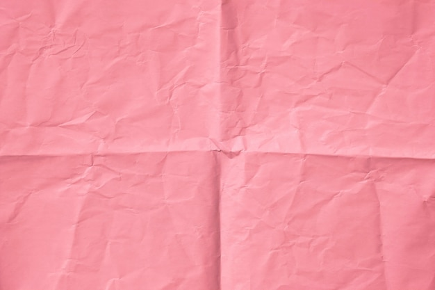 Pink paper ,top view of pink crumpled paper background
