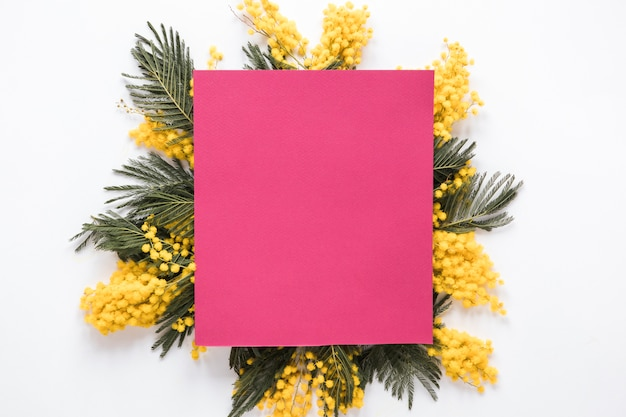 Pink paper on yellow flower branches