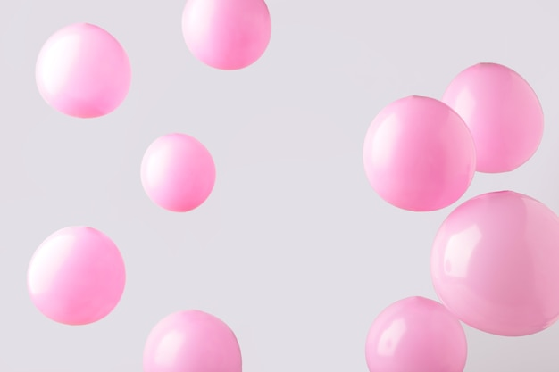 灰色の背景にピンクのパステルカラーの風船。ミニマリズム。上面図