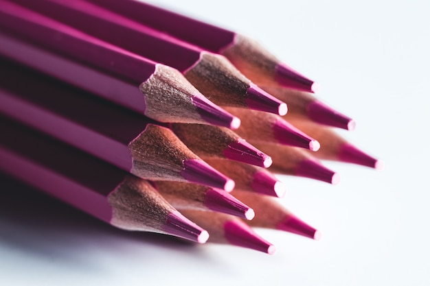 Pink pencils on a white background. office, drawing.