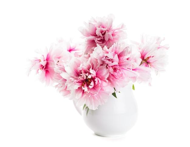 白で隔離の花瓶のピンクの牡丹