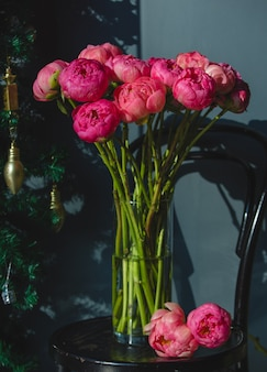 Pink peonies inside glass vase