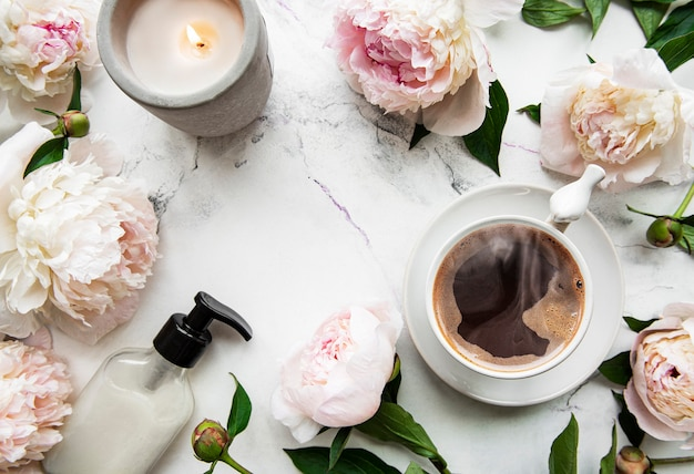 Pink  peony and cup of coffee  in beautiful style on white background