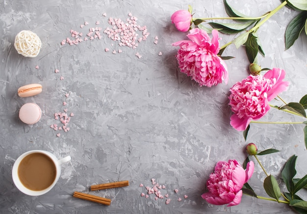 Pink peony flowers and a cup of coffee