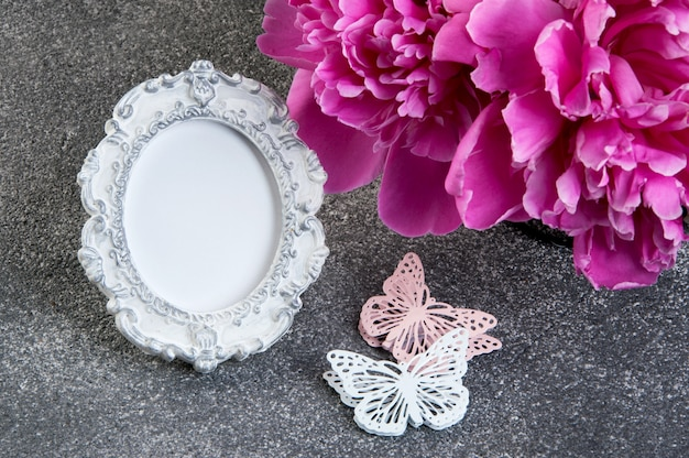 Pink peony, shabby frame and butterflies