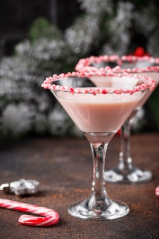 Pink peppermint martini with candy cane rim