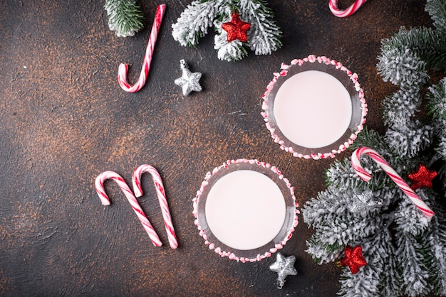 Pink peppermint martini with candy cane