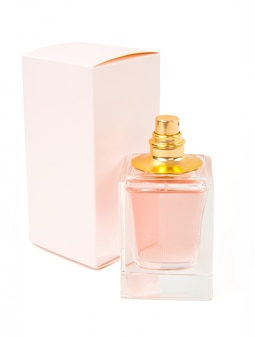 Pink perfume bottle and box on white background