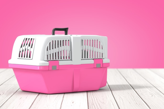 Pink pet travel plastic cage carrier box on a wooden table and pink background. 3d rendering