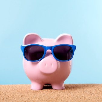 Pink piggy bank beach travel vacation savings sunglasses.